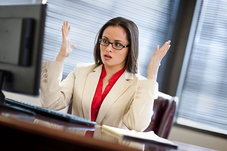 business woman frustrated at desk Busy Professionals Body Solution